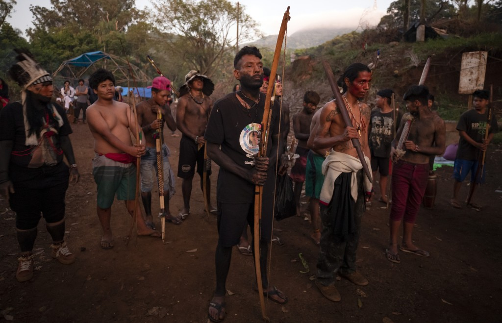 Guarani Mbya indigenous men wait for police to enter the property they have been occupying for just over a month in an attempt to stop real estate dev...