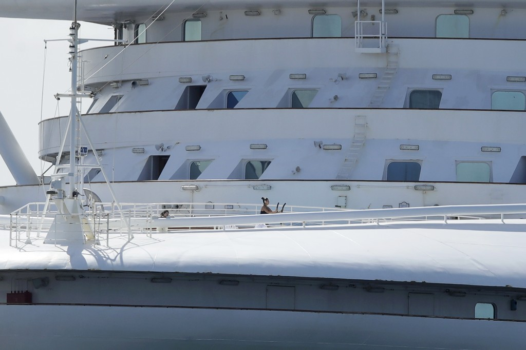 A woman uses excersise equipment on the Grand Princess, a cruise ship carrying multiple people who have tested positive for COVID-19, after docking at...