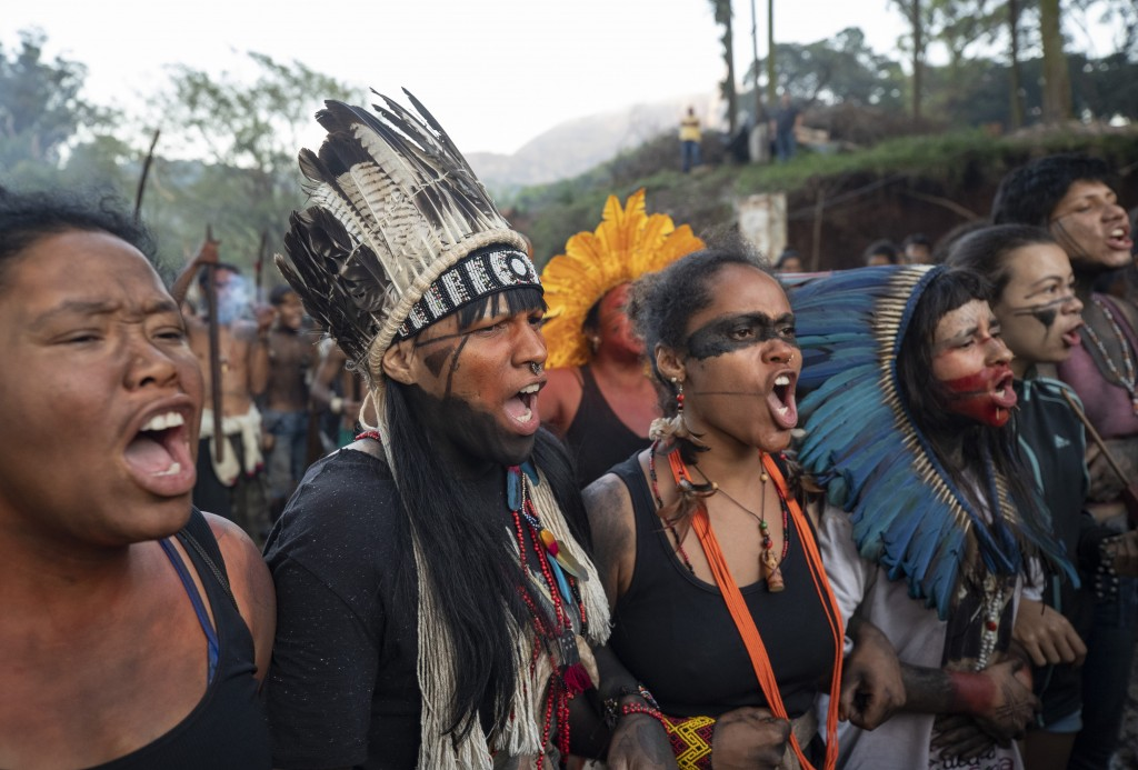 Guarani Mbya indigenous woman chant indigenous songs as they wait for police to enter the property they have been occupying for just over a month in a...