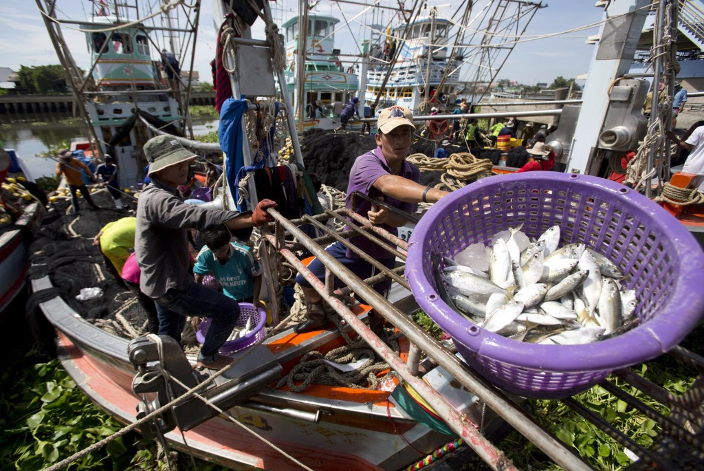 FILE - In this Sept. 3, 2013, file photo , fishermen unload fish following a fishing trip in the Gulf of Thailand in Samut Sakhon Province, west of Ba...
