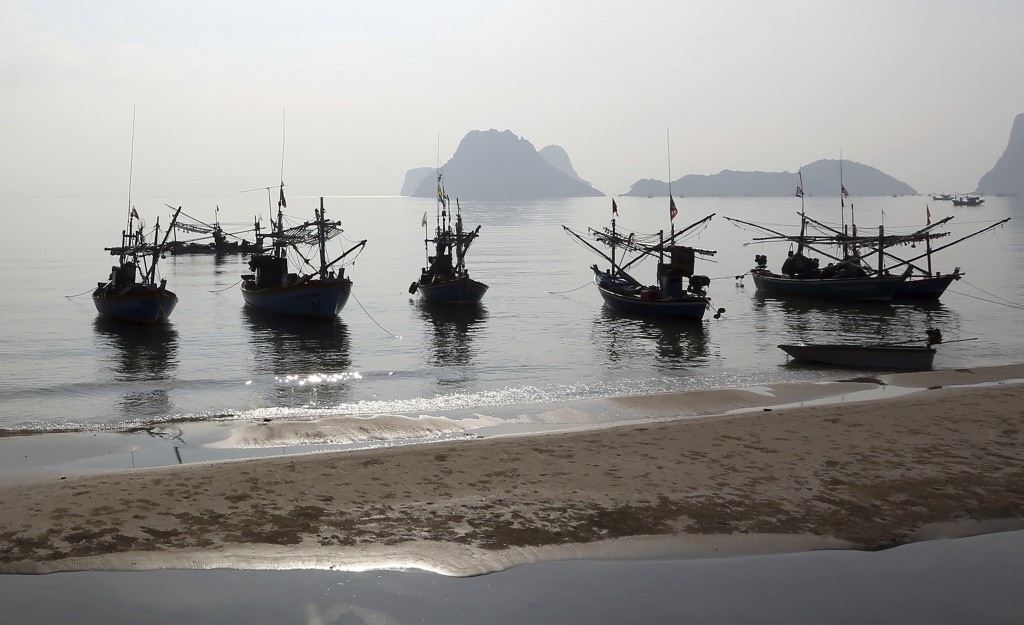 FILE - In this March 4, 2014, file photo,  fishing boats anchor off the coast in Prachuabkhirikhant province, southern Thailand. A report issued Tuesd...