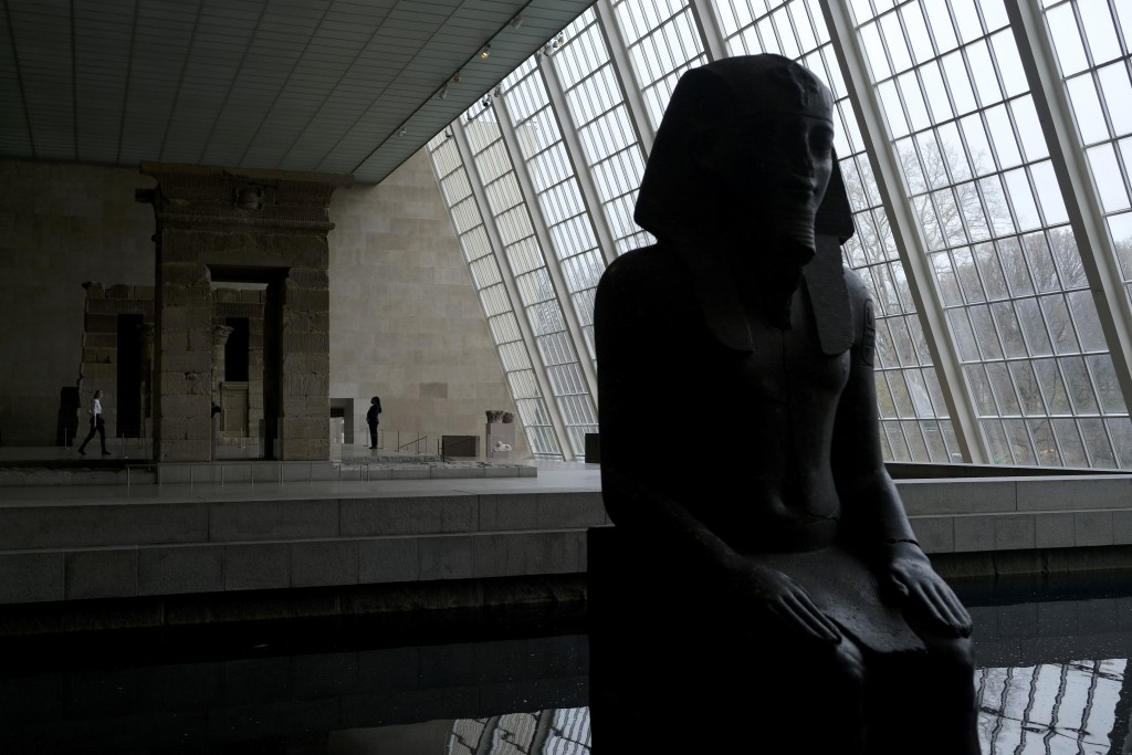 A few visitors walk around an Egyptian exhibit at the Metropolitan Museum of Art in New York, Tuesday, March 10, 2020. New York state is shuttering sc...