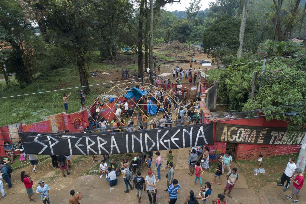 Guarani Mbya indigenous people gather outside a property they have been occupying in an attempt to stop real estate developer Tenda from constructing ...