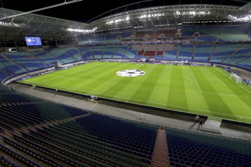 In this Tuesday, March 10, 2020 photo the empty stadium is pictured prior to the Champions League round of 16, 2nd leg soccer match between RB Leipzig...