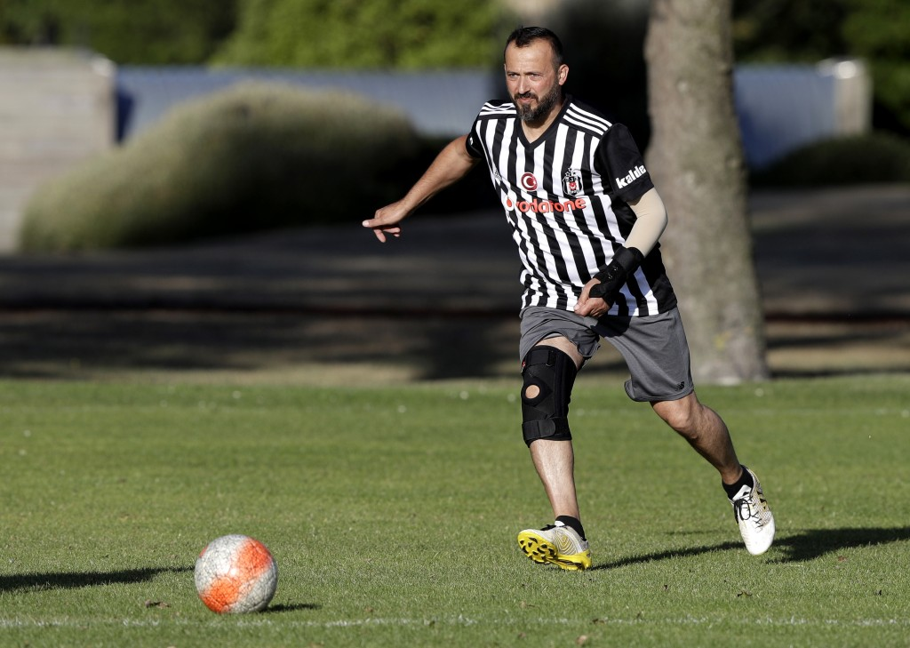 In this Wednesday, Feb. 26, 2020, photo, Al Noor mosque shooting survivor Temel Atacocugu chases the ball during a social game of soccer in Christchur...