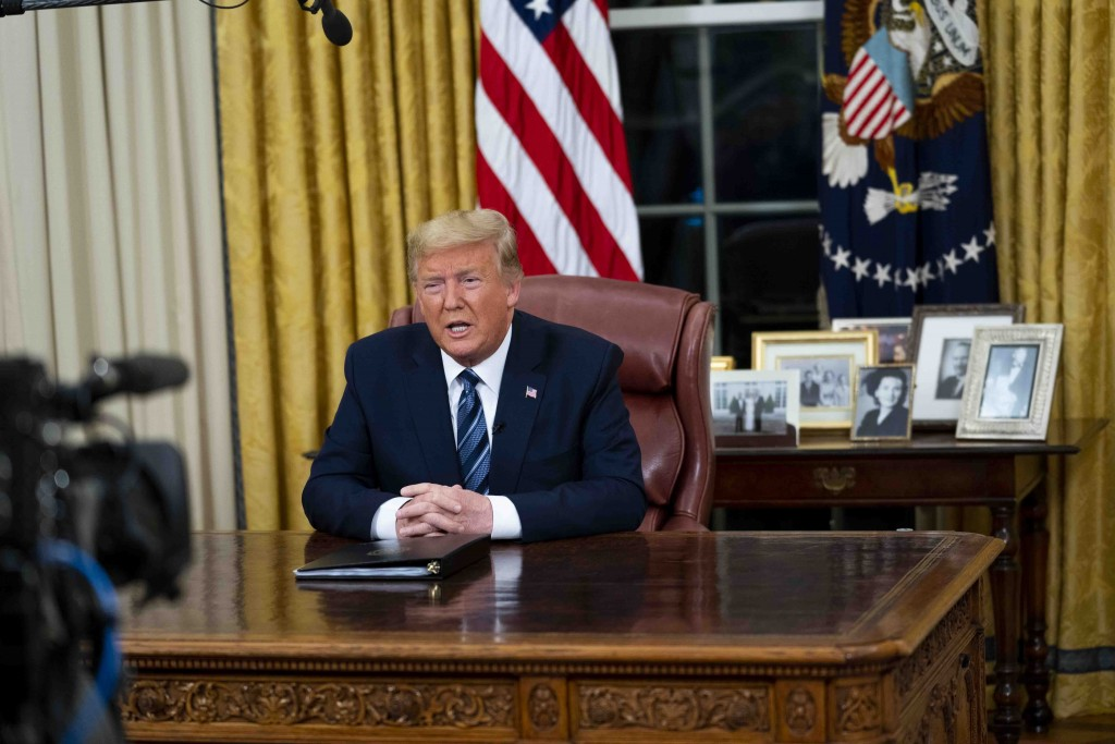President Donald Trump speaks in an address to the nation from the Oval Office at the White House about the coronavirus Wednesday, March, 11, 2020, in...