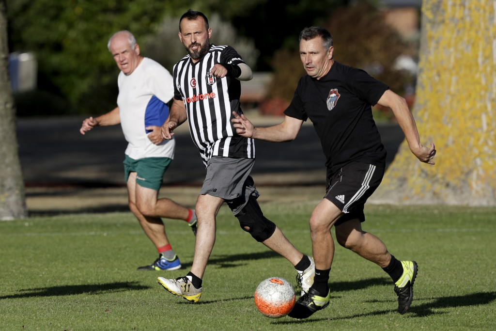 In this Wednesday, Feb. 26, 2020, photo, Al Noor mosque shooting survivor Temel Atacocugu, center, gestures during a social game of soccer in Christch...