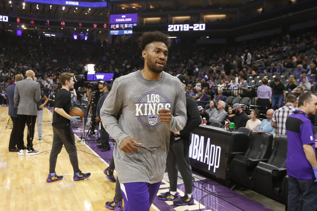 Sacramento Kings forward Jabari Parker runs off the court after the team's NBA basketball game against the New Orleans Pelicans was postponed at the l...