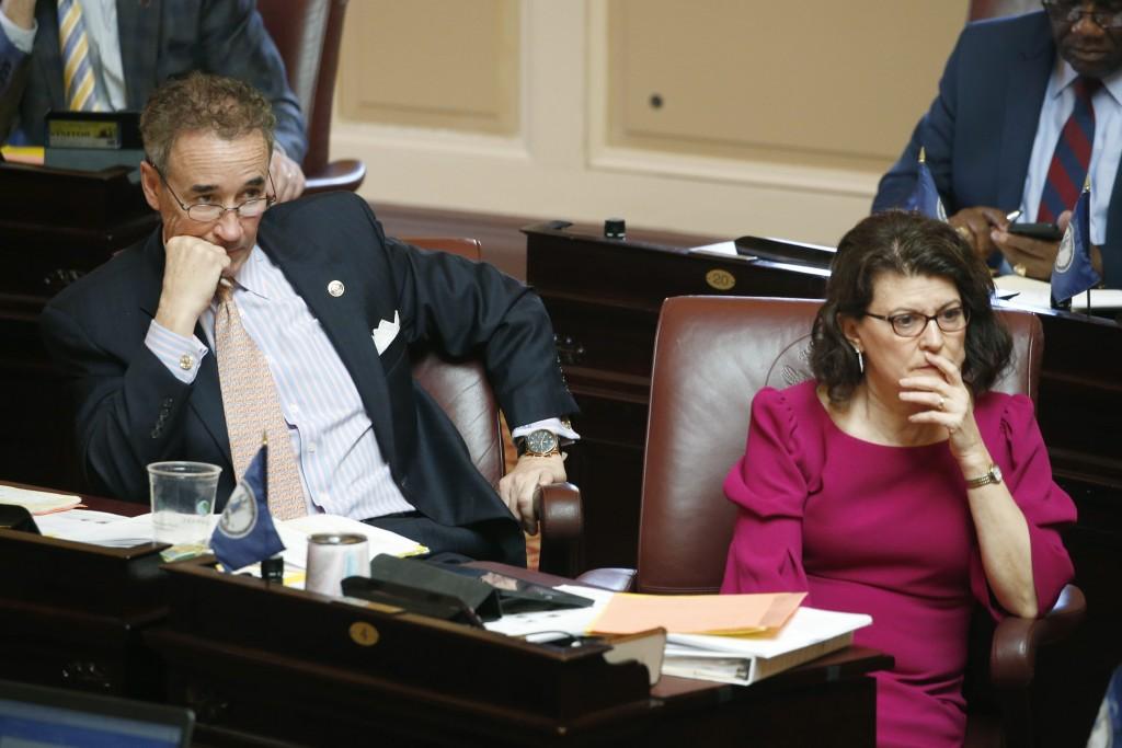 In this Wednesday, March 4, 2020 photo, State Sen. Joe Morrissey, D-Richmond, left, and Sen. Barbara Favola, D-Arlington, listen to debate on the floo...