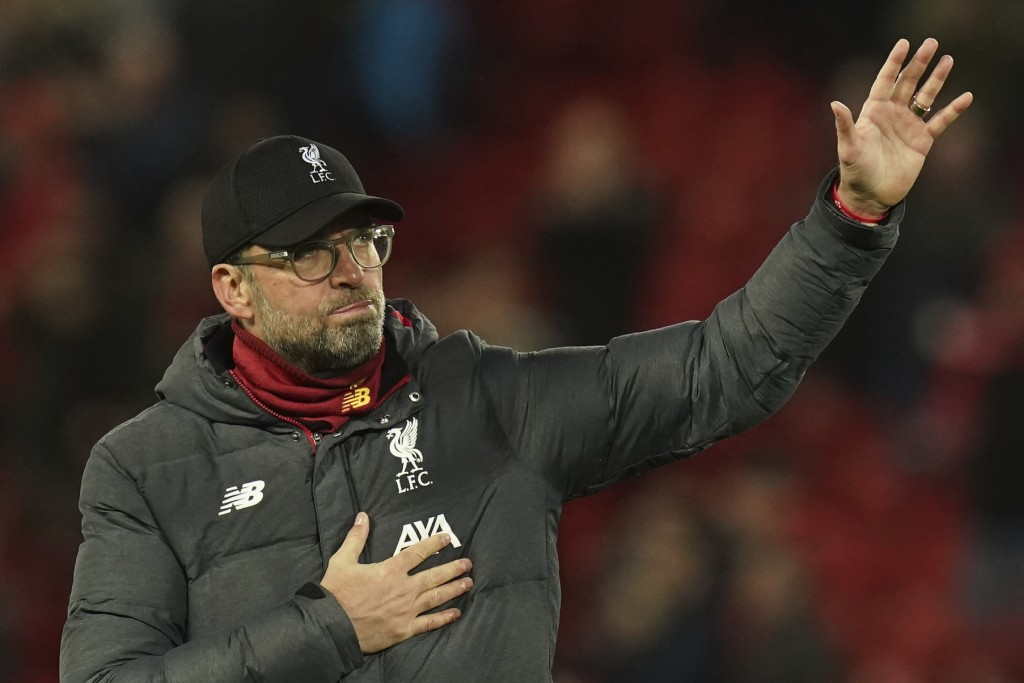 Liverpool's manager Jurgen Klopp applauds fans at the end of the second leg, round of 16, Champions League soccer match between Liverpool and Atletico...