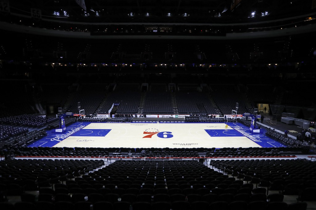 The empty court is seen at the Wells Fargo Center after an NBA basketball game between the Philadelphia 76ers and the Detroit Pistons, Wednesday, Marc...