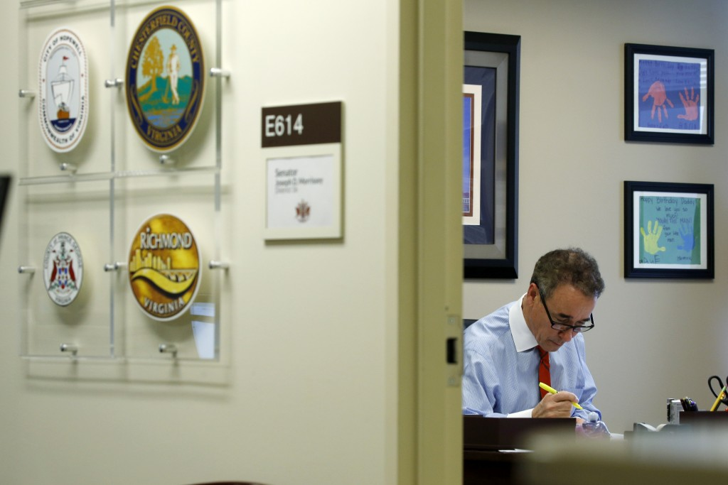 In this Thursday, March 5, 2020 photo, Virginia State Sen. Joe Morrissey, D-Richmond, works in his office at the Capitol in Richmond, Va. The former p...