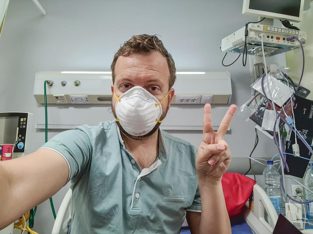 In this photo provided by Matt Swider, posted on Twitter on March 9, 2020, American tourist Matt Swider, takes a selfie while in quarantine in the nor...