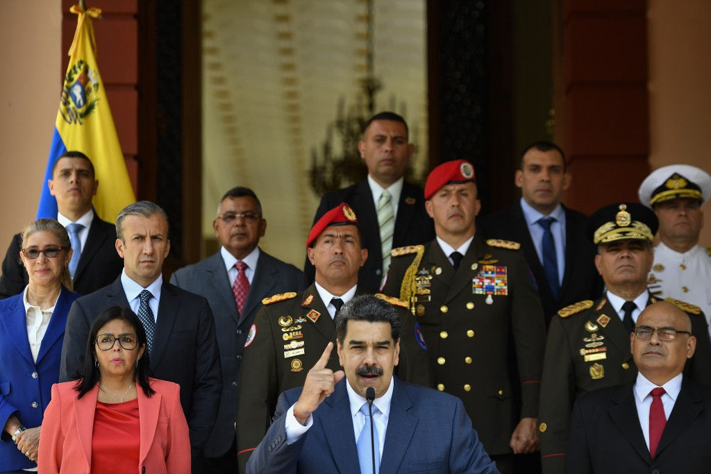Venezuela's President Nicolas Maduro speaks at a press conference at the Miraflores Presidential Palace in Caracas, Venezuela, Thursday, March 12, 202...