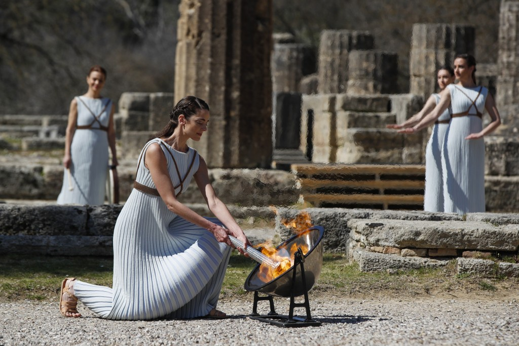 Greek actress Xanthi Georgiou, playing the role of the High Priestess, during the official flame lighting ceremony at the closed Ancient Olympia site,...