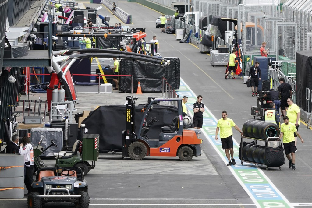 Workers pack up in pit lane after the cancellation of the Australian Formula One Grand Prix in Melbourne, Friday, March 13, 2020. The first F1 Grand P...