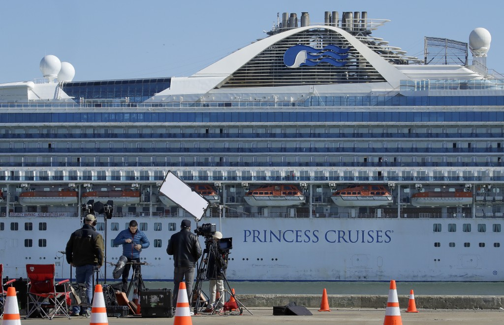 A media crew prepare to film with the Grand Princess cruise ship in the background at the Port of Oakland Thursday, March 12, 2020, in Oakland, Calif....