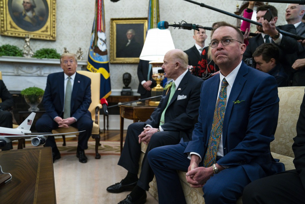 Former acting White House chief of staff Mick Mulvaney listens as President Donald Trump speaks during a meeting with Irish Prime Minister Leo Varadka...