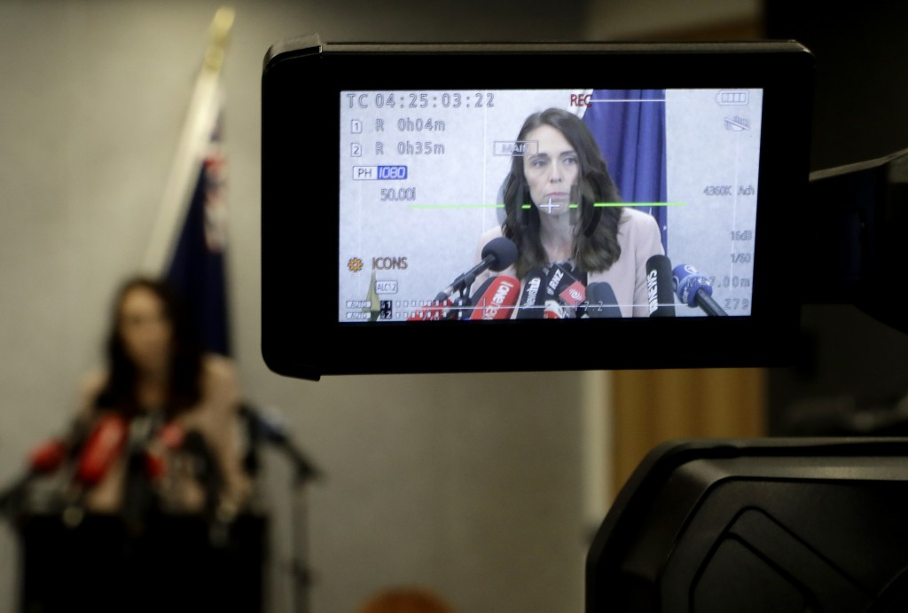 New Zealand Prime Minister Jacinda Ardern is seen on a TV camera's LCD screen as she addresses a press conference in Christchurch, New Zealand, Friday...
