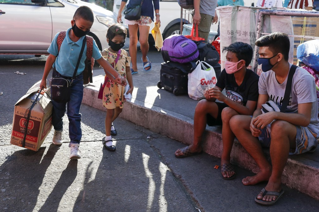 Manila placed under curfew for a month as deaths rise