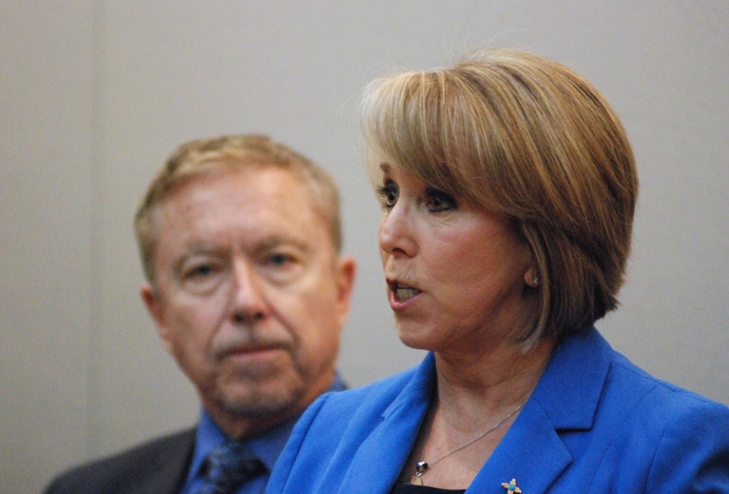 In this Wednesday, March 11, 2020, photo New Mexico Gov. Michelle Lujan Grisham, right, announces a public health emergency in response to the state's...