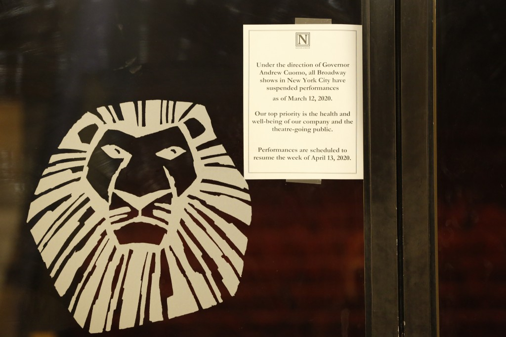 "A sign announcing the suspension of all Broadway shows is posted on a door at the Minskoff Theatre, where ""The Lion King"" had been playing, Thursday, ..."