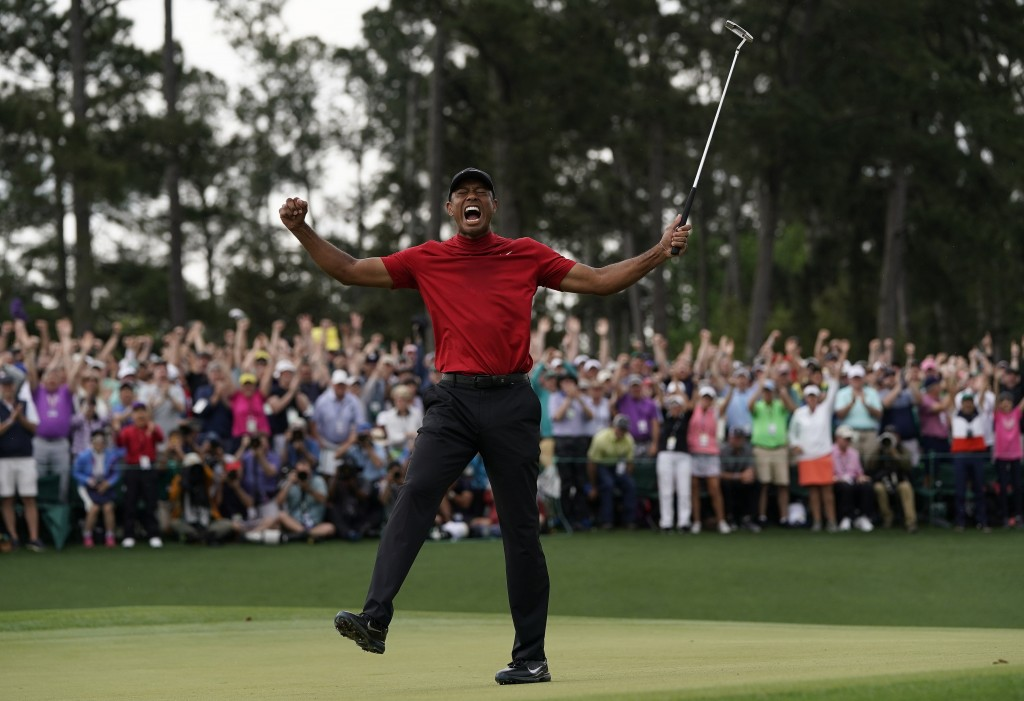 FILE - In this April 14, 2019, file photo, Tiger Woods reacts as he wins the Masters golf tournament in Augusta, Ga. Augusta National decided Friday, ...