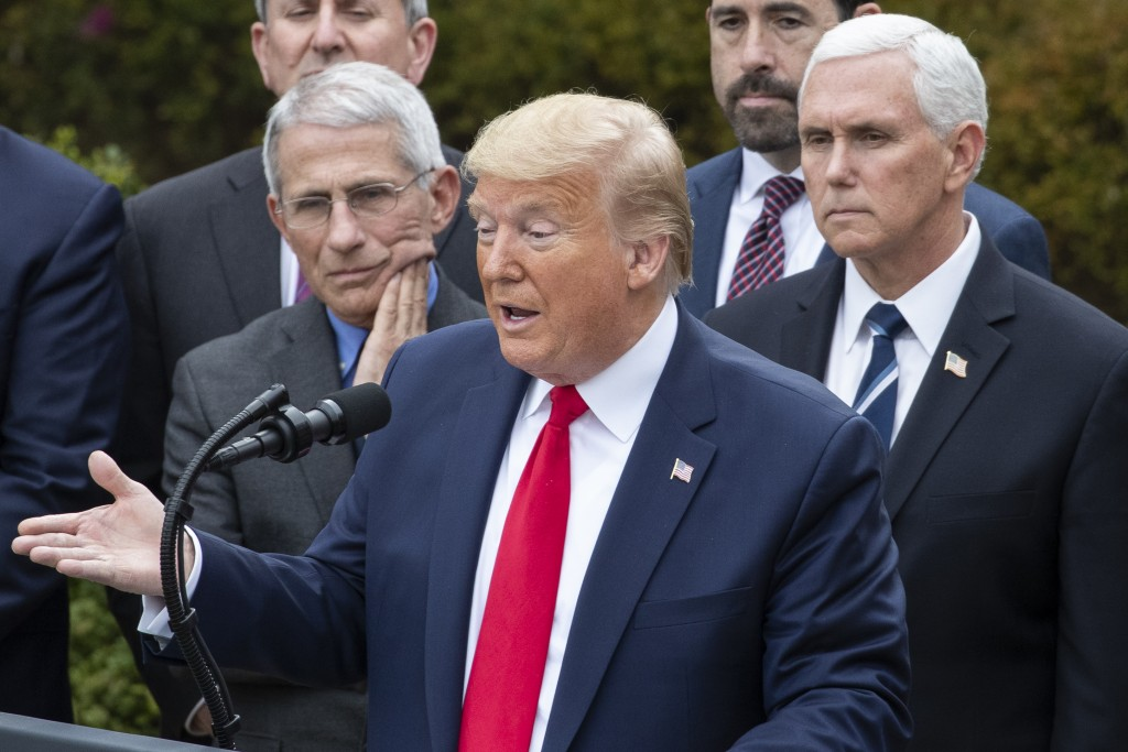 President Donald Trump, accompanied by Dr. Anthony Fauci, director of the National Institute of Allergy and Infectious Diseases, left, and Vice Presid...