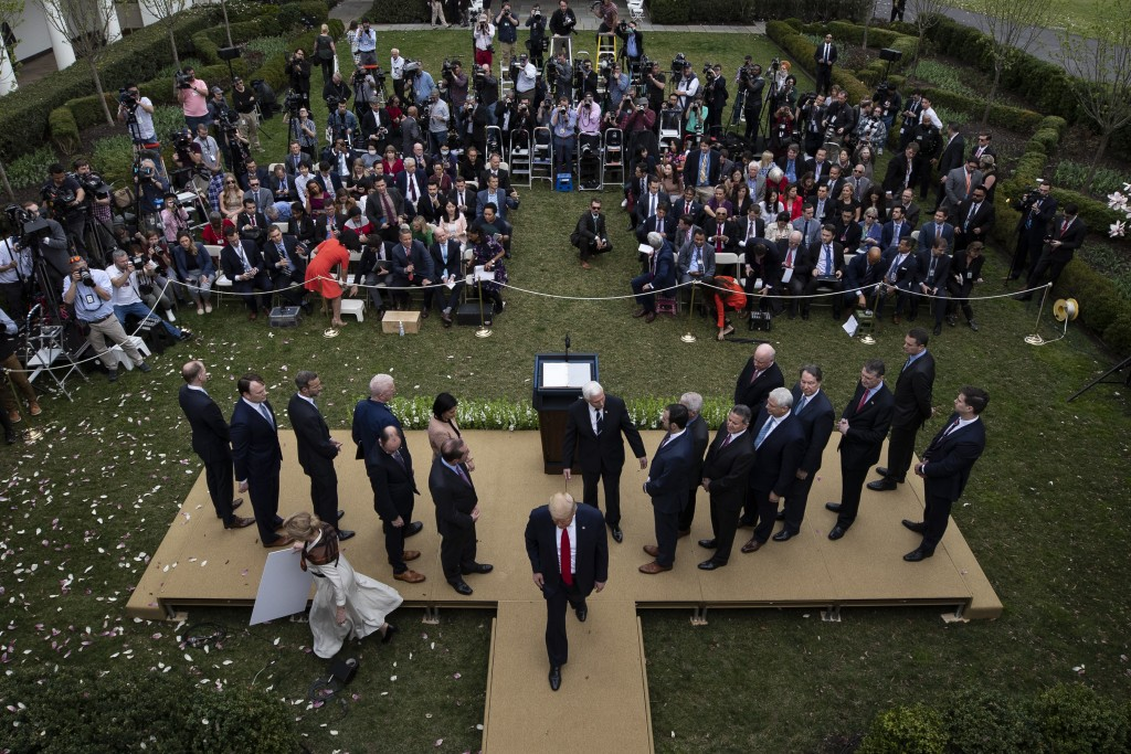 President Donald Trump departs after speaking during a news conference about the coronavirus in the Rose Garden at the White House, Friday, March 13, ...