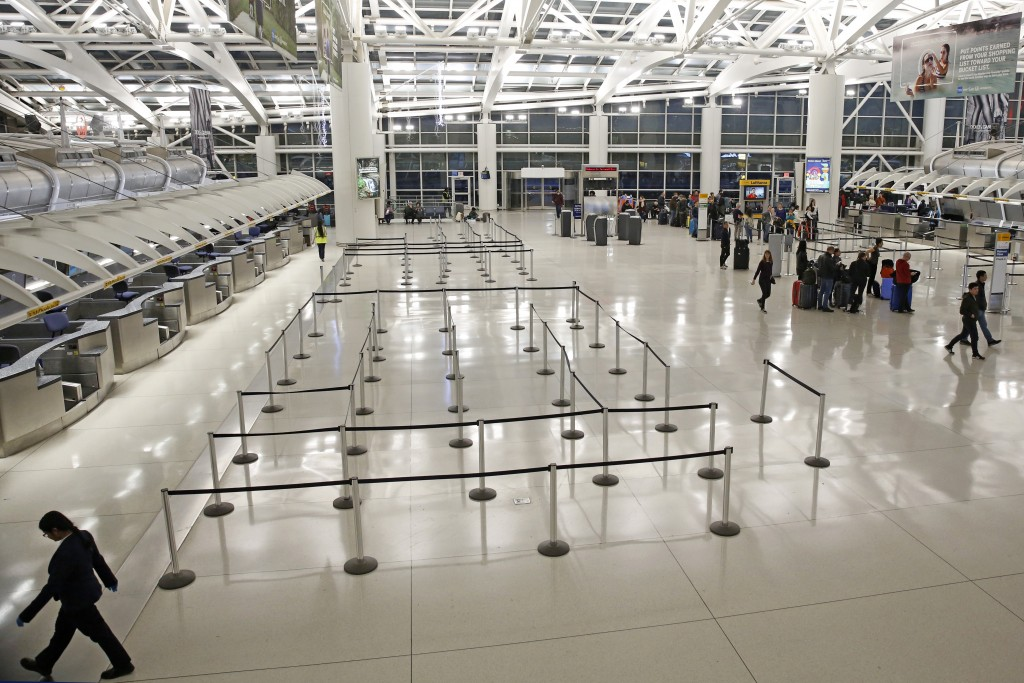 People visit an international terminal at John F. Kennedy airport, Friday, March 13, 2020, in New York. A ban on travelers from most European countrie...