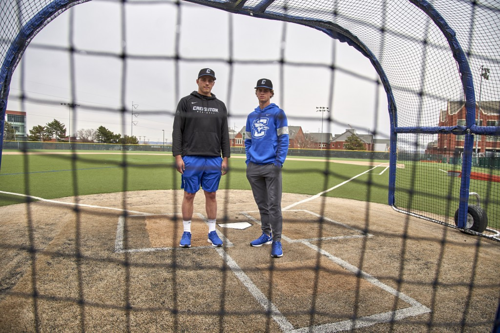In this March 13, 2020 photo, Creighton NCAA college baseball pitchers Ben Dotzler and Tommy Steier, right, pose for a photo at home plate in Omaha, N...