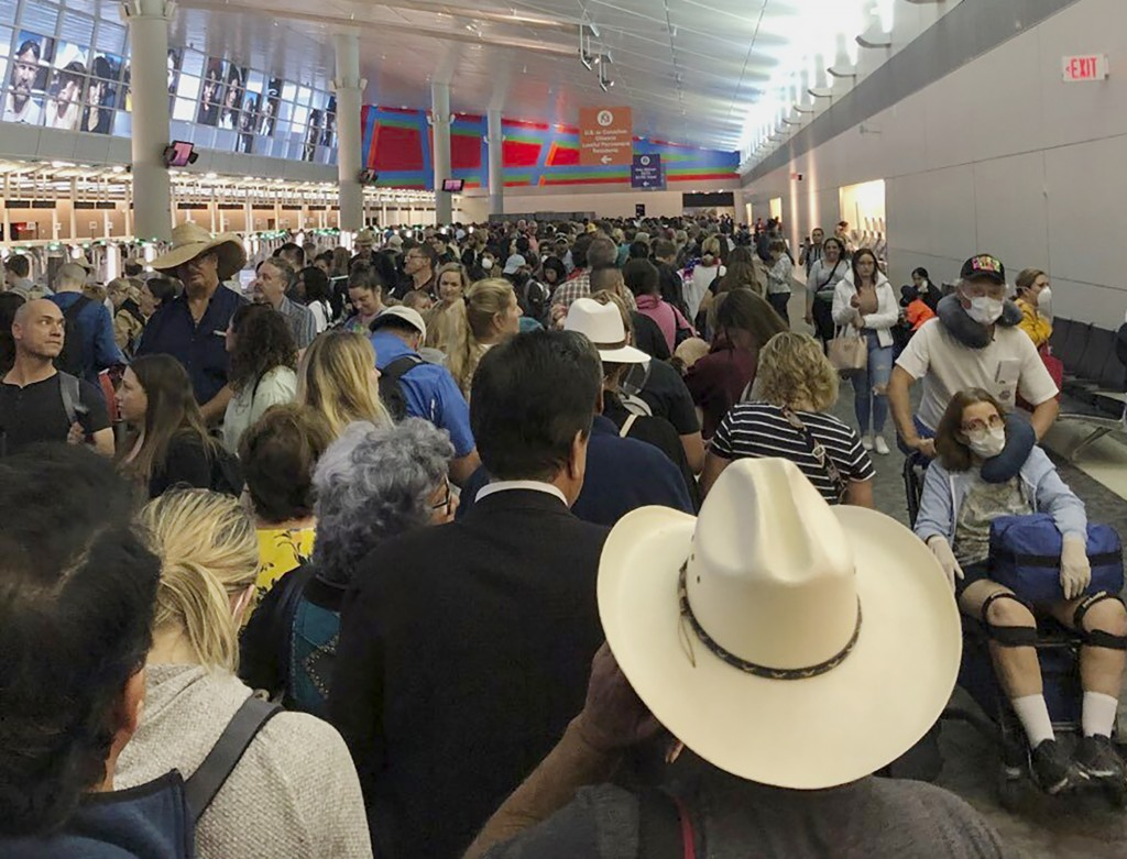 In this photo provided by Austin Boschen, people wait in line to go through the customs at Dallas Fort Worth International Airport in Grapevine, Texas...