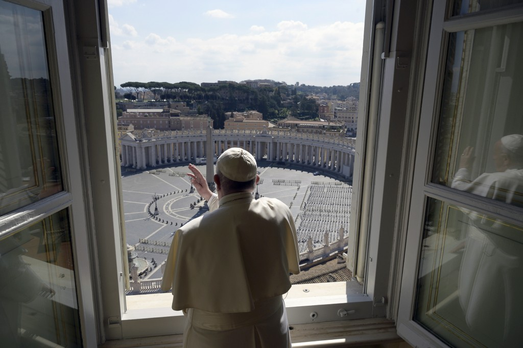 Pope Francis delivers his blessing from inside the Apostolic library at the Vatican, Sunday, March 15, 2020. Pope Francis has praised people who could...