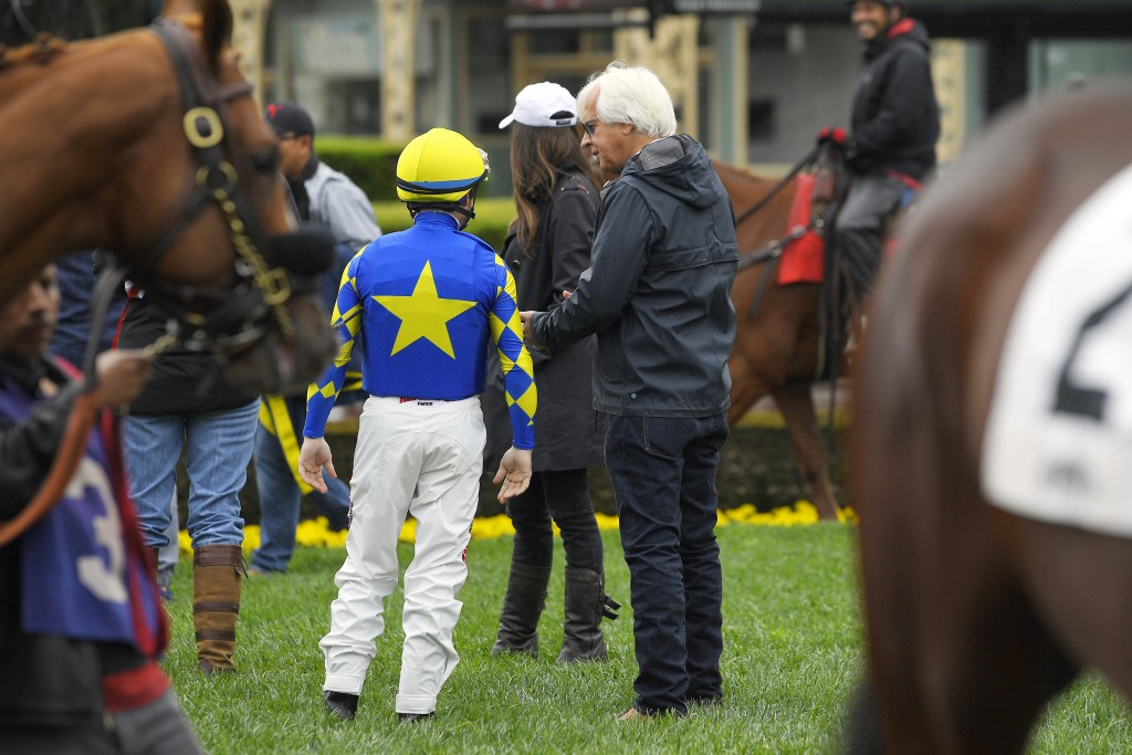 Jockey Drayden Van Dyke, left, talks with trainer Bob Baffert before riding Charlatan in the sixth race at Santa Anita on Saturday, March 14, 2020, in...
