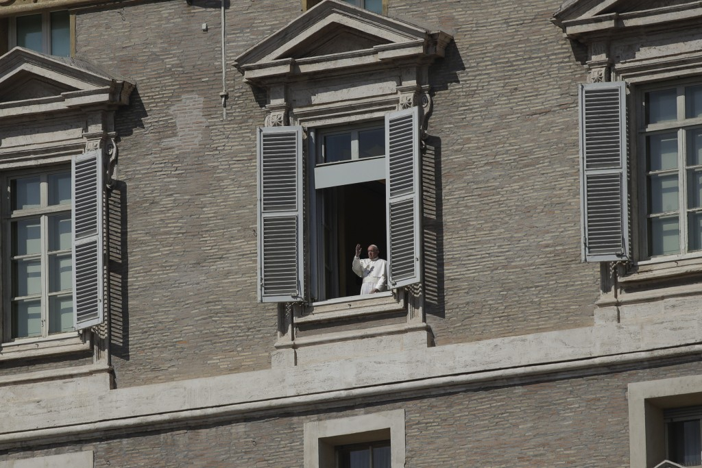 Pope Francis delivers his blessing from his studio window overlooking St. Peter's Square at the Vatican, Sunday March 15, 2020. For most people, the n...