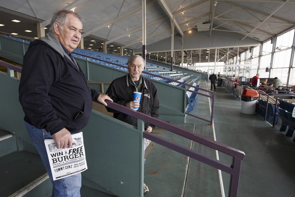 Ron Tenski and Jerry Moritz, left, who had arrived to Fonner Park in Grand Island, Neb., for the horse races, Saturday, March 14, 2020, leave after th...