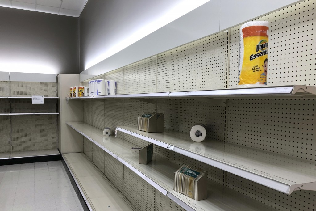 CORRECTS DATELINE TO LACEY, WASH., INSTEAD OF OLYMPIA, WASH. - Nearly empty shelves, that usually hold toilet paper, facial tissue and paper towels, a...