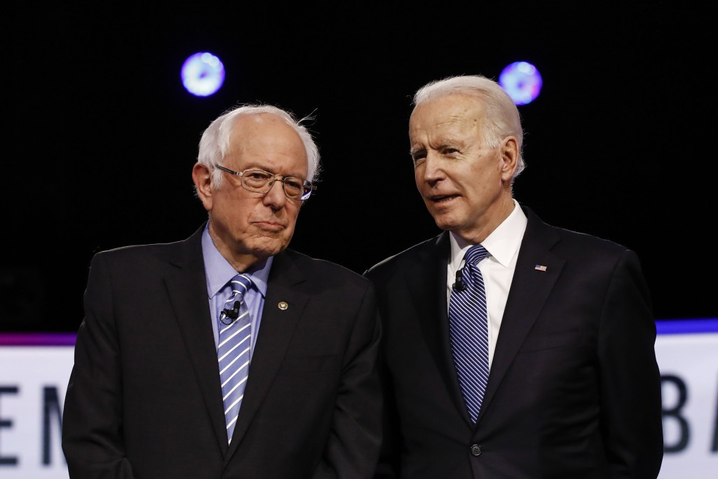 FILE - In this Tuesday, Feb. 25, 2020 file photo, Democratic presidential candidates, Sen. Bernie Sanders, I-Vt., left, and former Vice President Joe ...