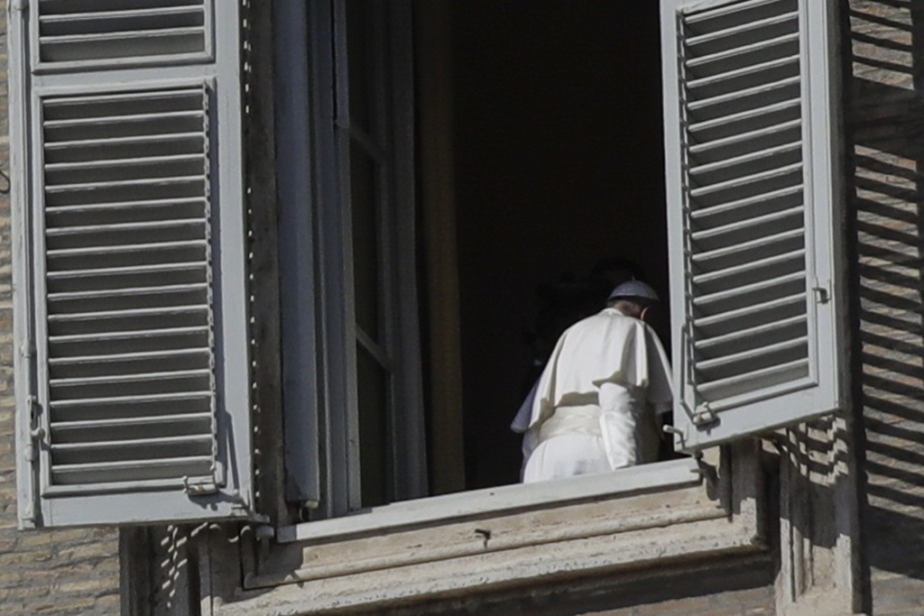 Pope Francis leaves after delivering his blessing from his studio window overlooking St. Peter's Square at the Vatican, Sunday March 15, 2020. For mos...