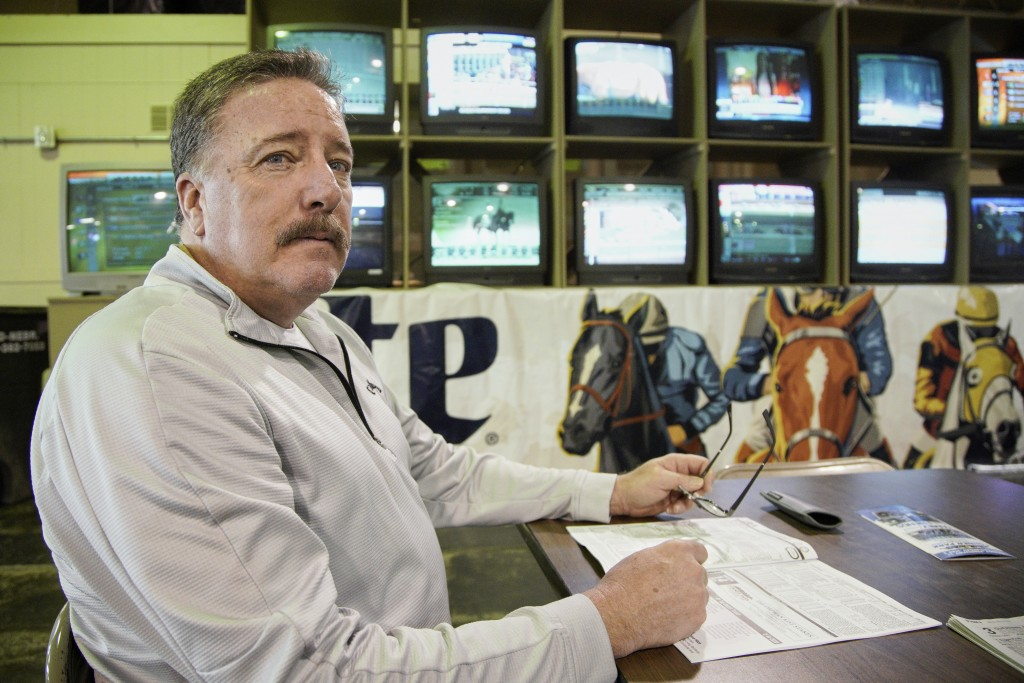 Joe Brown waits for the horses to race at Fonner Park in Grand Island, Neb., Saturday, March 14, 2020. Fonner was one of the few sporting venues in th...