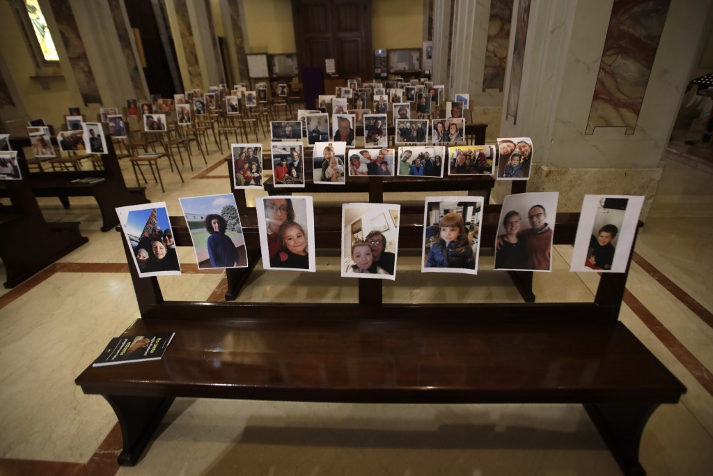 Selfies sent by parishioners lie on the benches of the Robbiano church as Masses for the faithful have been suspended following Italy's coronavirus em...