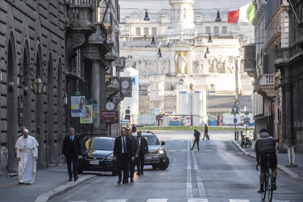 Pope Francis walks to reach S. Marcello al Corso church, where there is a miraculous crucifix that in 1552 was carried in a procession around Rome to ...