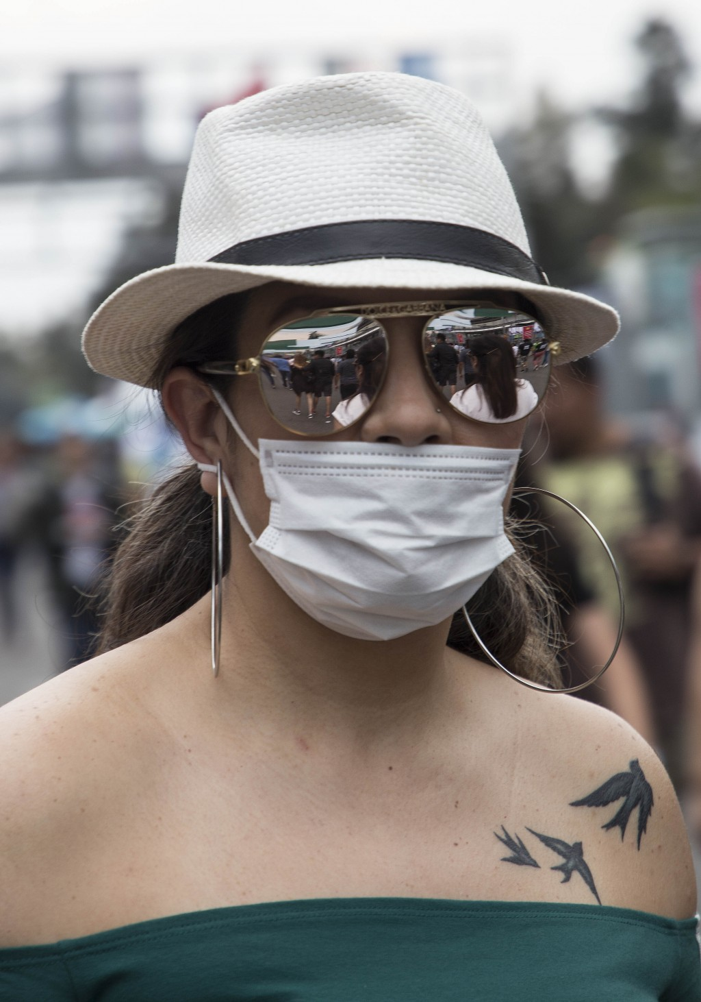 A spectator attends the Vive Latino music festival in Mexico City, Sunday, March 15, 2020. The two-day rock festival is one of the most important and ...