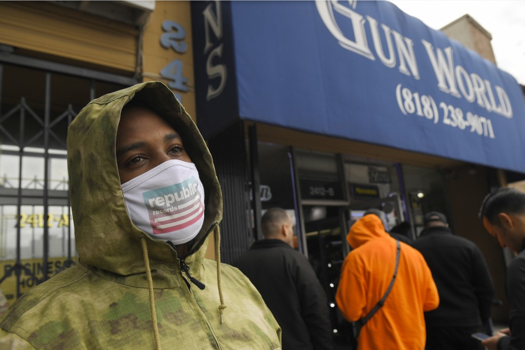 A gun store customer that gave his name only at John waits in line, Sunday, March 15, 2020, in Burbank, Calif. As consumers are buying all kinds of go...