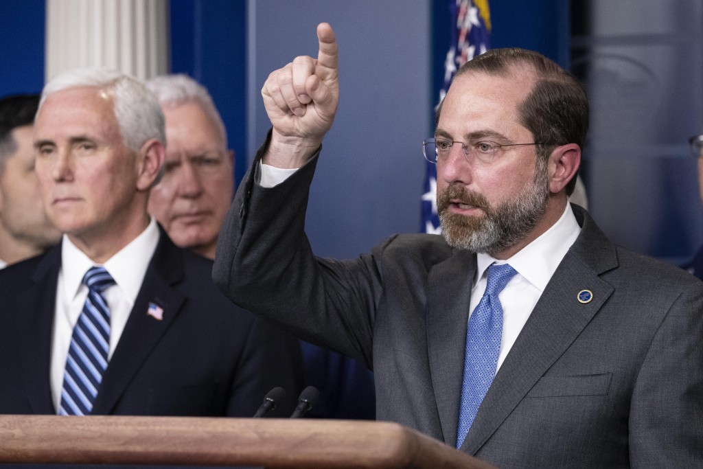 Health and Human Services Secretary Alex Azar speaks, with Vice President Mike Pence behind him, during a briefing about the coronavirus in the James ...