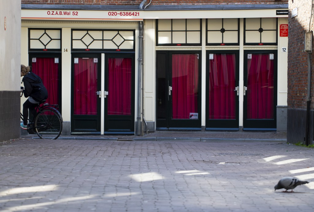 Closed windows of sex workers are seen in the Red Light District of Amsterdam, Netherlands, Monday, March 16, 2020. Health minister Bruno Bruins order...