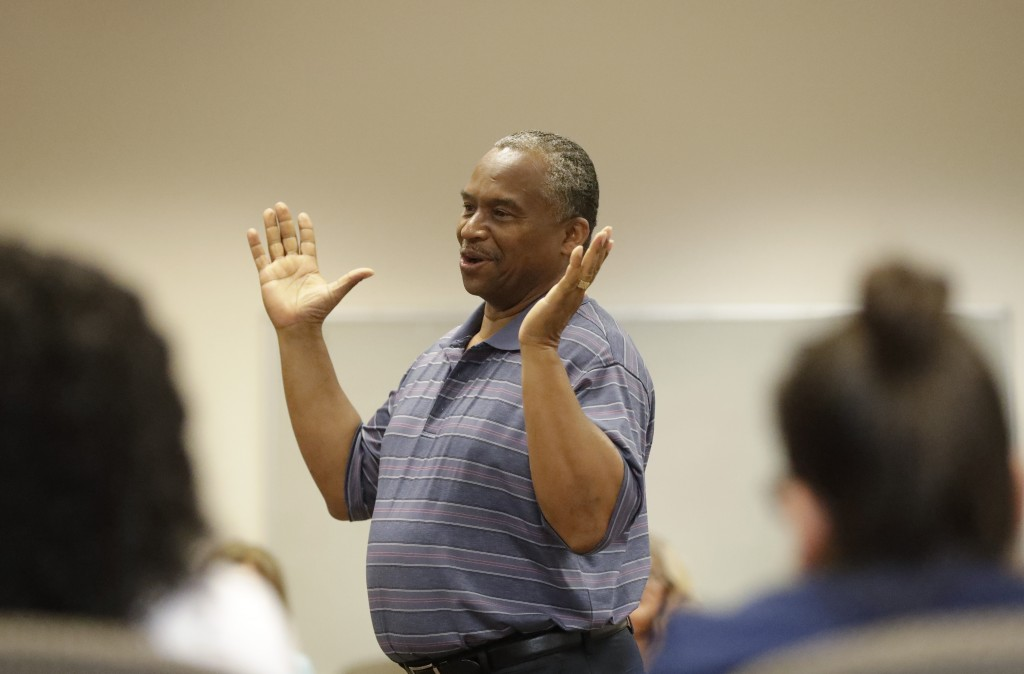 In this, Wednesday, Feb. 12, 2020 photo, Vincent Keeys, standing, president of the NAACP in Collier County, talks to a group of nonprofit leaders and ...