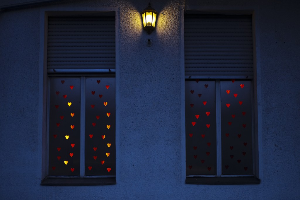 Illuminated hearts cover the windows of the three room brothel 'Lankwitzer 7' in Berlin, Germany, Friday, March 13, 2020. Sex for sale has long been a...