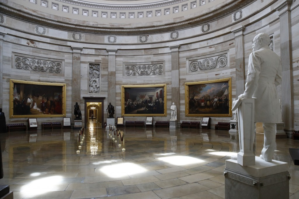 The U.S. Capitol Rotunda sits empty on Capitol Hill in Washington, Monday, March 16, 2020. Congress has shut the Capitol and all Senate and House offi...