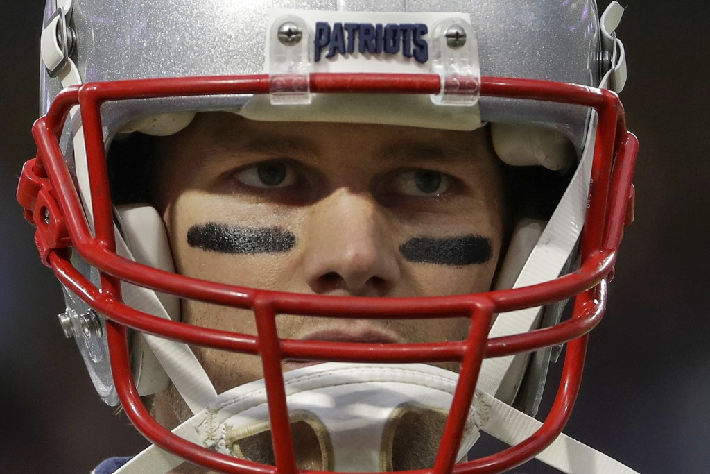 FILE - In this Feb. 4, 2018, file photo, New England Patriots quarterback Tom Brady warms up before the NFL Super Bowl 52 football game against the Ph...
